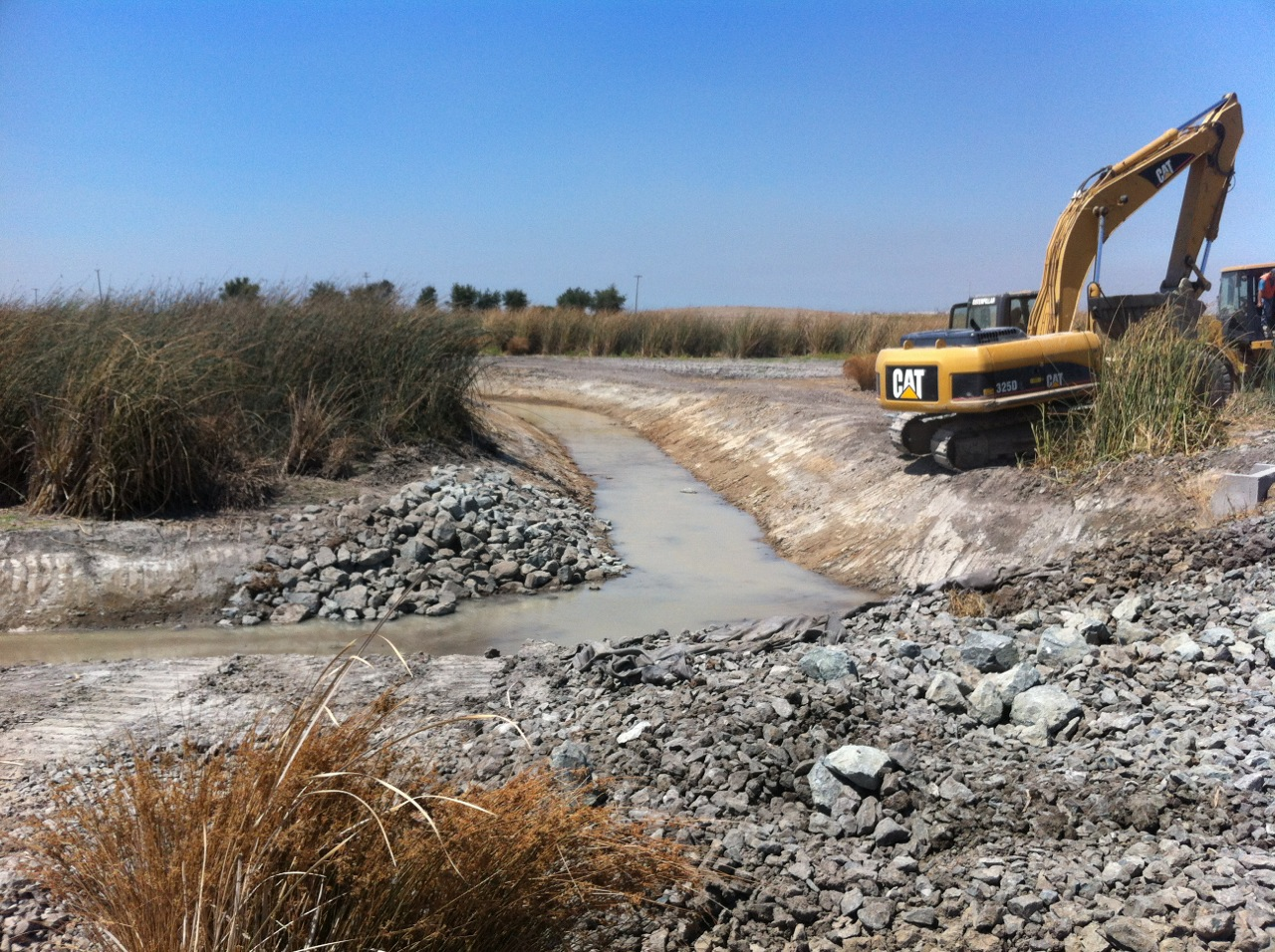 Working on the BKS tract North Course Channel Clearing Project.